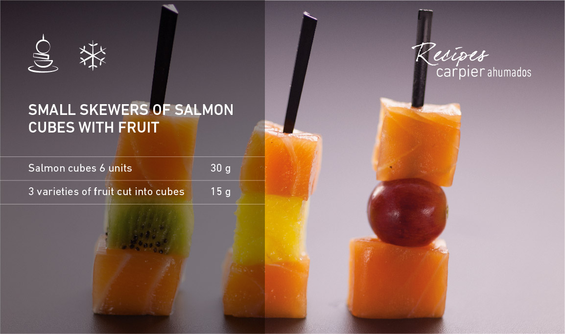 Small skewers of salmon cubes with fruit